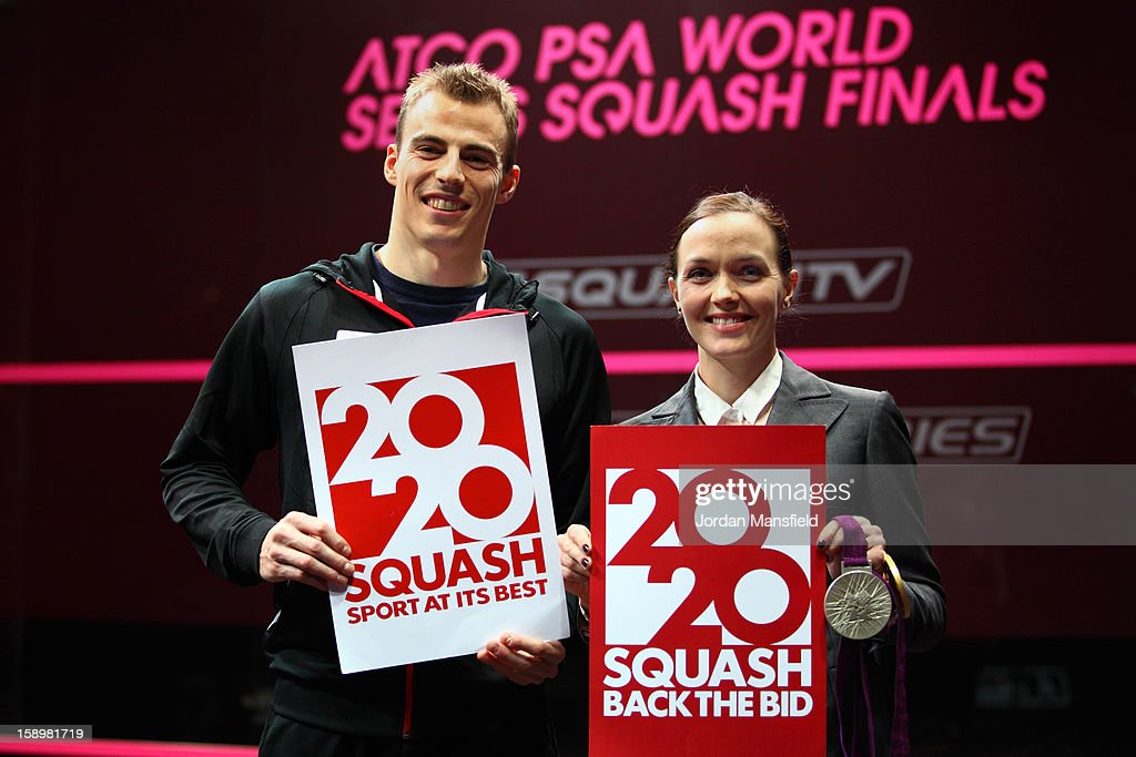<a gi-track='captionPersonalityLinkClicked' href=/galleries/search?phrase=Victoria+Pendleton&family=editorial&specificpeople=228525 ng-click='$event.stopPropagation()'>Victoria Pendleton</a> and Nick Matthew pose with 2020 Back the Bid signs aimed at getting Squash into the 2020 Olympics during Day 3 of the World Series Finals helf at Queens Club on January 4, 2013 in London, England.