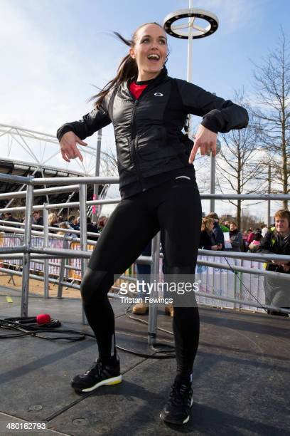 Victoria Pendleton dances at the starting line of the Sainsbury's Sport Relief Mile challenge at Queen Elizabeth Olympic Park on March 23 2014 in...