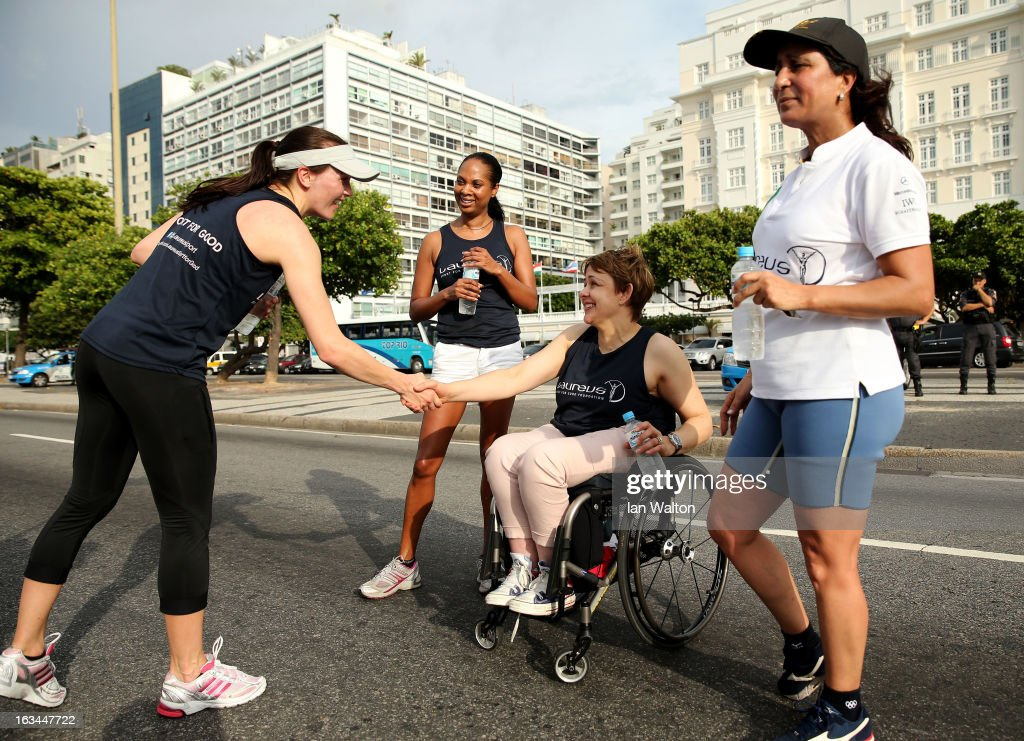 <a gi-track='captionPersonalityLinkClicked' href=/galleries/search?phrase=Victoria+Pendleton&family=editorial&specificpeople=228525 ng-click='$event.stopPropagation()'>Victoria Pendleton</a> of Great Britain (L) shakes the hand of Laureus Academy Member Tanni Grey - Thompson with Laureus Academy Member <a gi-track='captionPersonalityLinkClicked' href=/galleries/search?phrase=Nawal+El+Moutawakel&family=editorial&specificpeople=215203 ng-click='$event.stopPropagation()'>Nawal El Moutawakel</a> (R) and Michelle Moses (2ndL) on the finish line of the Laureus Run Copacabana Beach on March 10, 2013 in Rio de Janeiro, Brazil.