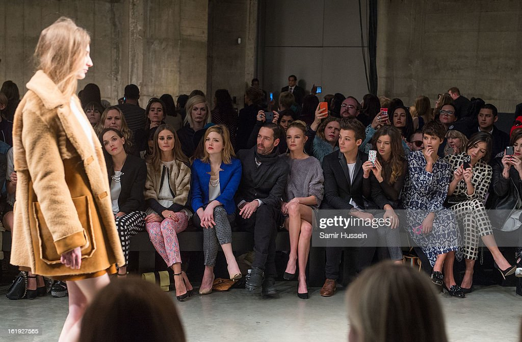 Victoria Pendleton, Olivia Palermo, Holliday Grainger, Michael Polish, Kate Bosworth, Louis Tomlinson from One Direction, Eleanor Calder, Pixie Geldof and Daisy Lowe attend the Topshop Unique show at the Tate Modern during London Fashion Week Fall/Winter 2013/14 on February 17, 2013 in London, England.