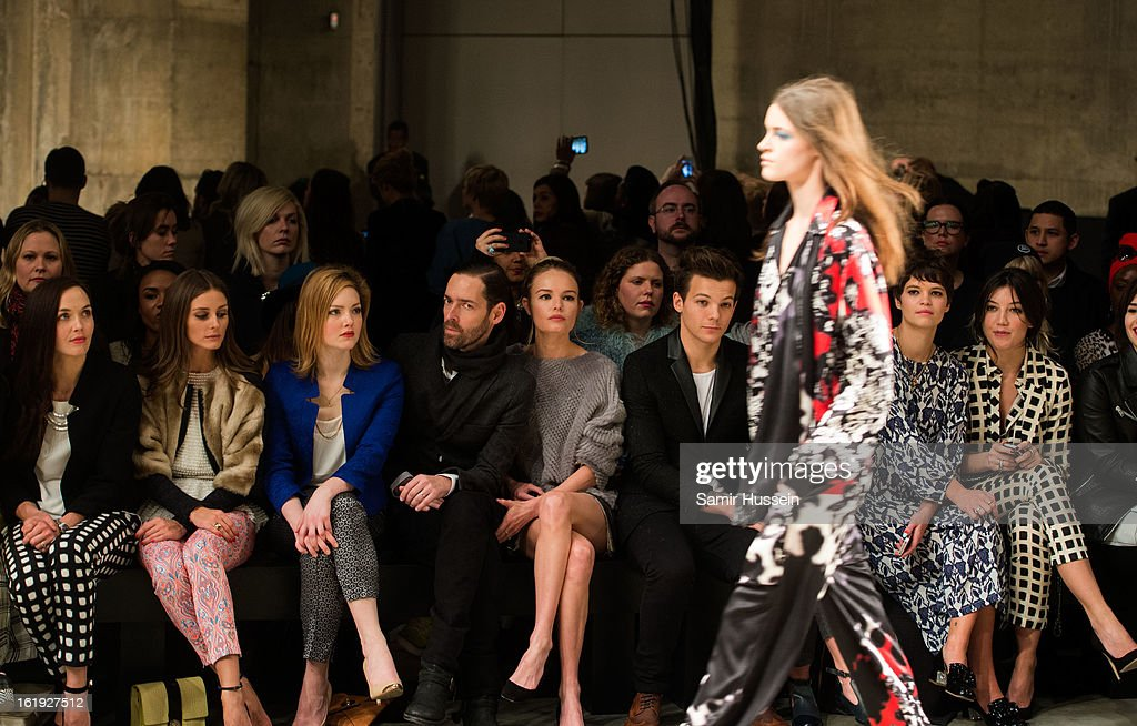 Victoria Pendleton, Olivia Palermo, Holliday Grainger, Victoria Pendleton, Michael Polish, Kate Bosworth, Louis Tomlinson from One Direction, Eleanor Calder, Pixie Geldof and Daisy Lowe attend the Topshop Unique show at the Tate Modern during London Fashion Week Fall/Winter 2013/14 on February 17, 2013 in London, England.