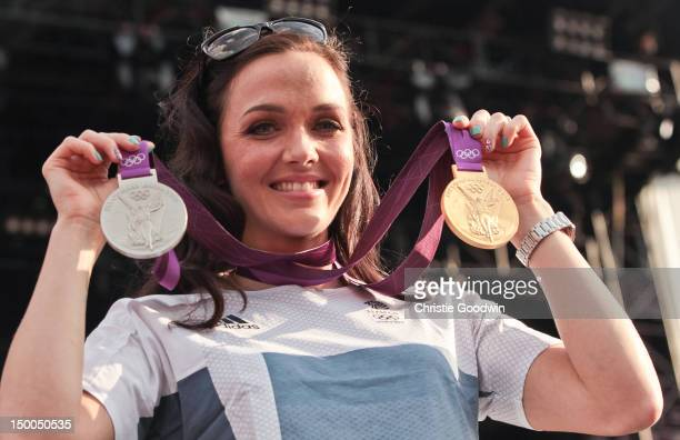 Victoria Pendleton poses with her Olympic gold medal for keirin and silver for sprint cycling competitions at the London 2012 Olympics greets the...