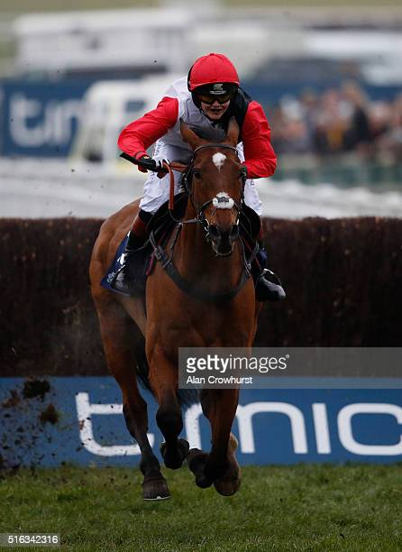 Victoria Pendleton riding Pacha De Polder clear the last to finish fifth in The St James's Place Foxhunter Steeple Chase Challenge Cup during the...