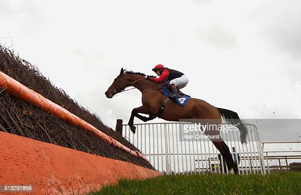 Victoria Pendleton riding Pacha Du Polder clear the fence in front of the grandstands before winning The Betfair Swithching Saddles Hunters' Steeple...