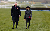 Victoria Pendleton walks the course with riding coach Alan Hill as she prepares to ride in The St James's Place Foxhunter Steeple Chase during the...