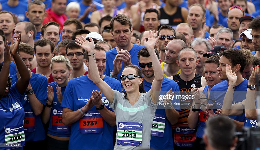 <a gi-track='captionPersonalityLinkClicked' href=/galleries/search?phrase=Victoria+Pendleton&family=editorial&specificpeople=228525 ng-click='$event.stopPropagation()'>Victoria Pendleton</a> waves to the crowds prior to The National Lottery Anniversary Run at The Queen Elizabeth Olympic Park on July 21, 2013 in Stratford, England.