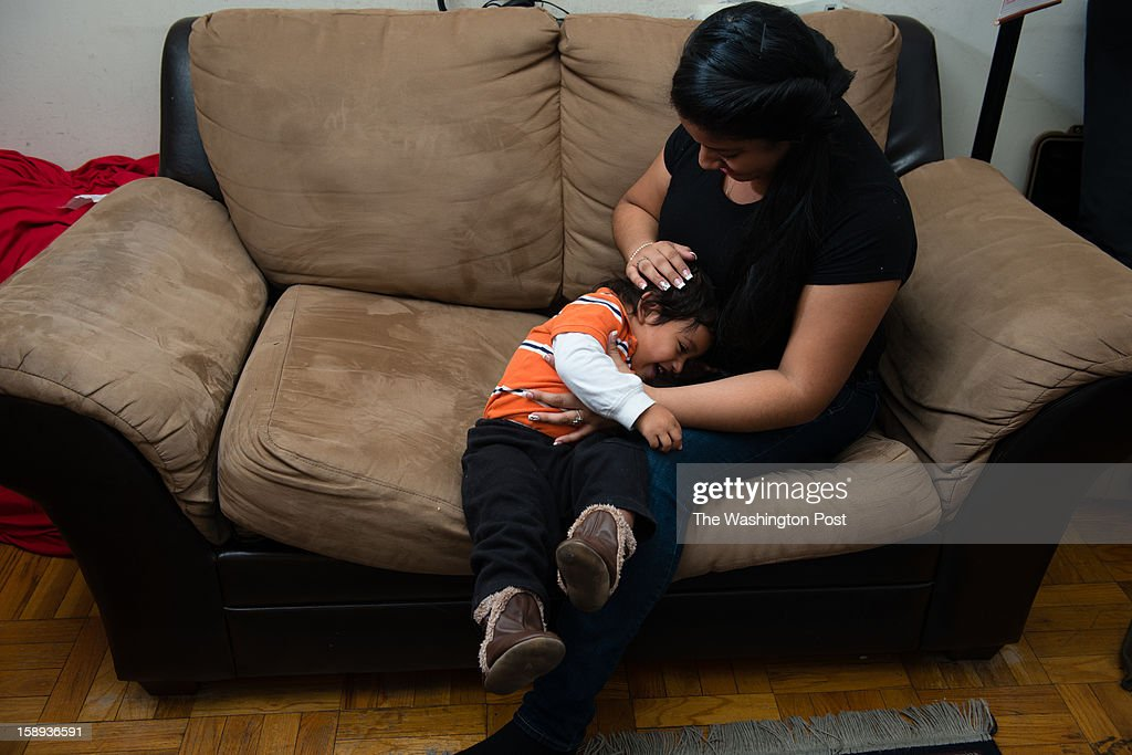 Victoria Perez Cruz, 18, is an honor roll student at Northwestern High School in Prince Georges County and a single mother of an almost two-year-old boy, Christian Perez, who attends a nursery in the school during the day. They cuddle on their sofa in their Hyattsville, MD apartment.