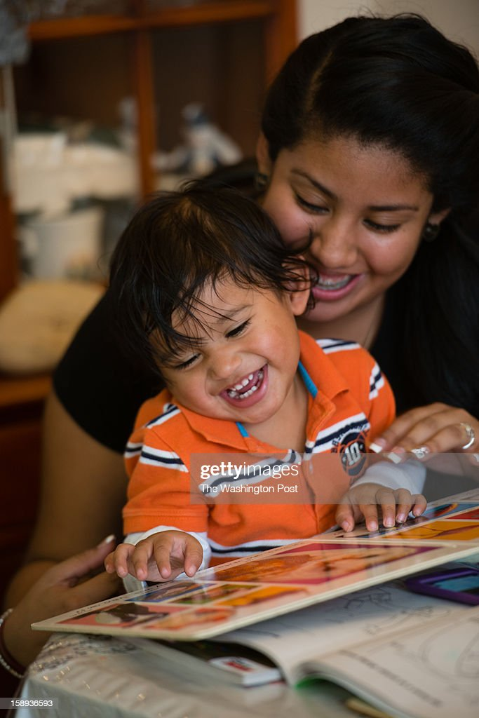 Victoria Perez Cruz, 18, is an honor roll student at Northwestern High School in Prince Georges County and a single mother of an almost two-year-old boy, Christian Perez, who attends a nursery in the school during the day. They read together before bed in their Hyattsville apartment.