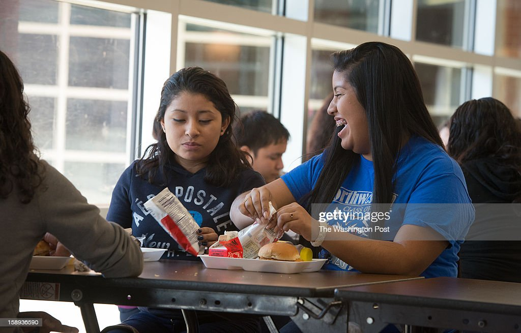 Victoria Perez Cruz, 18, right, is an honor roll student at Northwestern High School in Prince Georges County and a single mother of an almost two-year-old boy, Christian Perez, who attends a nursery in the school during the day. She has lunch with her friend, Anna Najera, 17, a junior at the school.