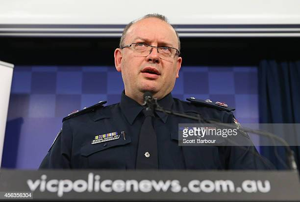 Victoria Police Deputy Commissioner Graham Ashton speaks to the media about the terrorism raids that took place in Melbourne this morning at Victoria...