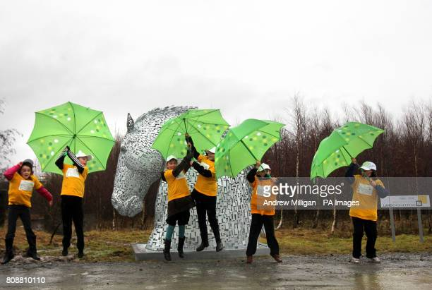 Victoria Primary School pupils struggle in the wind and rain next to a ten foot Kelpie at the site where a 43 million tourist attraction will be
