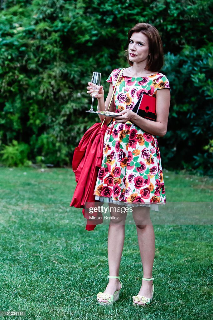 Victoria Protsenko seen wearing a Merce Munne dress, a jacket/trench Only from Italy, Gold Style's shoes and a Misako's handbag during the 'Festival Jardins de Pedralbes' on June 25, 2014 in Barcelona, Spain.