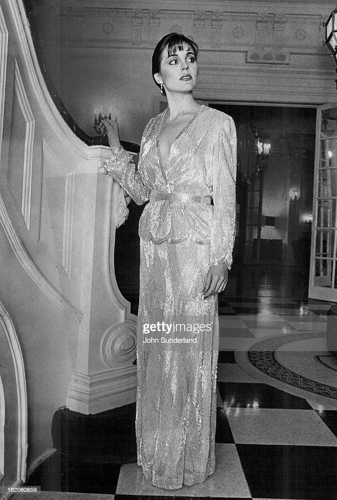 DEC 26 1981 DEC 29 1981 Victoria Royal's scallopedged jacket slim skirt are of allover shimmery ivory bugle beads $1300 Cates
