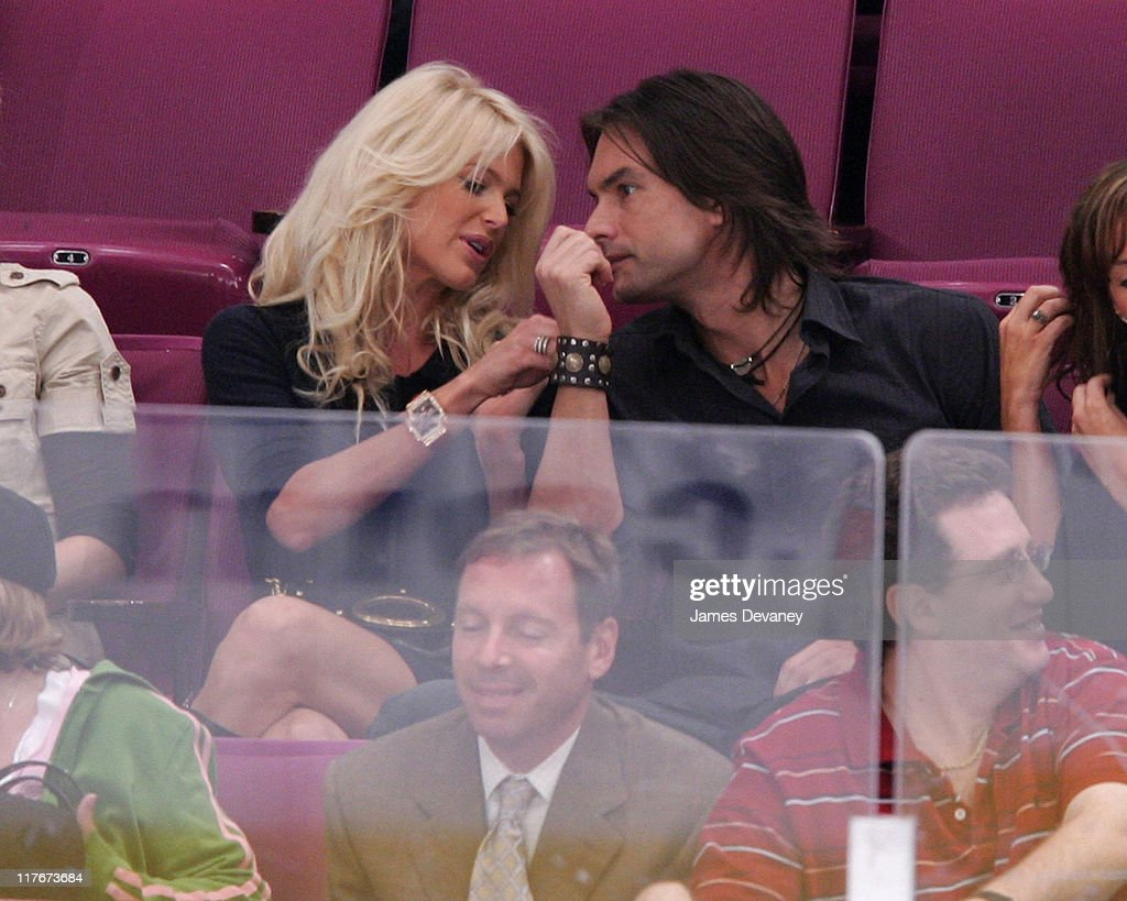 Victoria Silvstedt and Marcus Schenkenberg during Celebrities Attend Philadelphia Flyers vs New York Rangers Game October 10 2006 at Madison Square...