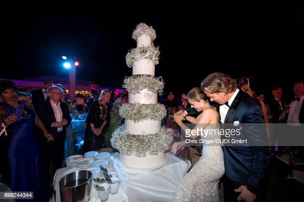 Victoria Swarovski and Werner Muerz cut the cake during their wedding on June 16 2017 in Trieste Italy