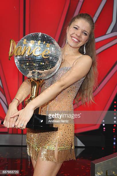 Victoria Swarovski celebrates after winning the final show of the television competition 'Let's Dance' on June 3 2016 in Cologne Germany