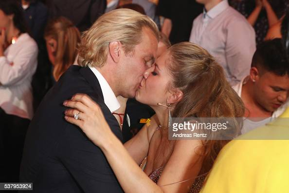 Victoria Swarovski kisses her fiance Werner Muerz after winning the final show of the television competition 'Let's Dance' on June 3 2016 in Cologne...