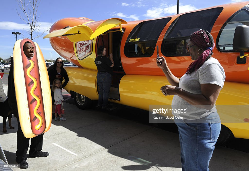 Victoria Taylor, right, gets a photo of her grandson Jontrail Taylor, 14, donning his cardboard hotdog cutout in front of the Wienermobile. The Oscar Mayer Wienermobile rolls through the metro area on its voyage across the country celebrating the 25th anniversary of having the giant hot dog piloted by recent college grads. The grads, who are part of the 'hotdogger tradition', must attend two weeks of 'Hotdog High' in Madison Wisconsin and serve as drivers and ambassadors of all things Oscar Mayer for one year. There is still a chance to see the road dog before it hits the highway on its return to Wisconsin from 11 a.m.- 4 p.m Saturday at the Walmart at 440 Wadsworth Blvd. in Lakewood.