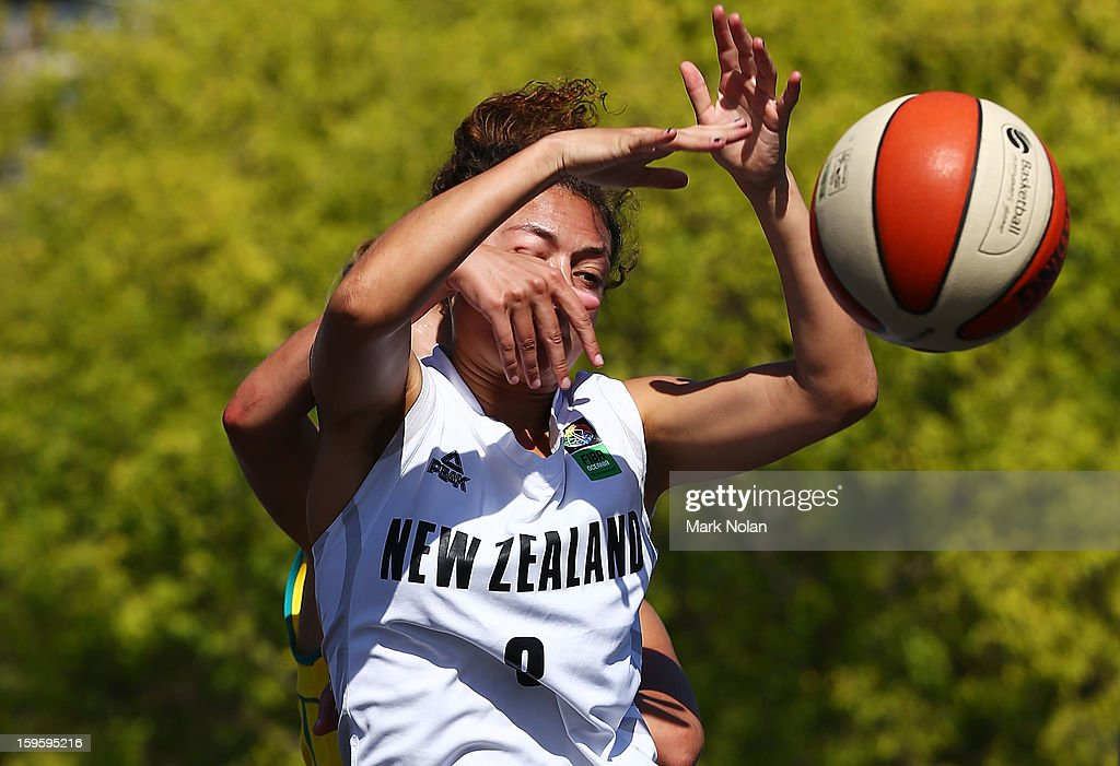 Victoria Unicomb of Australia Green fouls Ella Fotu of New Zealand in the Womens Basketball 3x3 match between Australia Green and New Zealand during day two of the 2013 Australian Youth Olympic Festival at Darling Harbour on January 17, 2013 in Sydney, Australia.