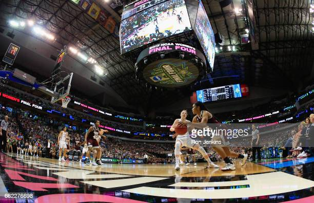 Victoria Vivians of the Mississippi State Lady Bulldogs drives against Katie Lou Samuelson of the Connecticut Huskies in the first half during the...