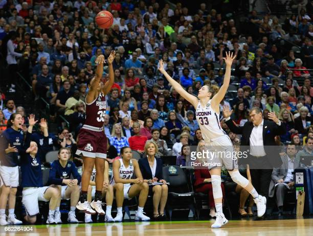Victoria Vivians of the Mississippi State Lady Bulldogs shoots a 3point shot against Katie Lou Samuelson of the Connecticut Huskies in the first half...