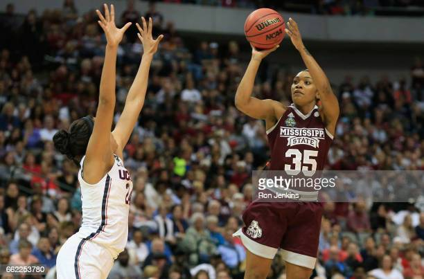 Victoria Vivians of the Mississippi State Lady Bulldogs shoots against Napheesa Collier of the Connecticut Huskies in the first quarter during the...