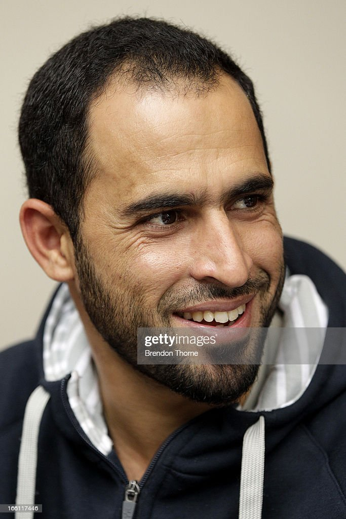 Victorian cricket player Fawad Ahmed looks on during a meeting with former Australian cricket players Damien Martyn and Stuart MacGill at the Sydney Cricket Ground Indoor Nets on March 28, 2013 in Sydney, Australia.