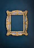 Victorian golden baroque frame on a green background