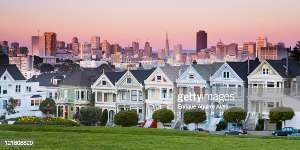 Victorian houses; Painted Ladies of the Alamo Square Historic District and modern skyline of Financial District, San Francisco, California, USA : Stock Photo