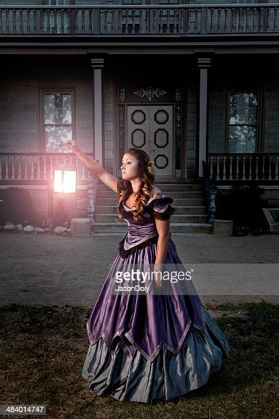 Victorian Lady Searching outside a Mansion