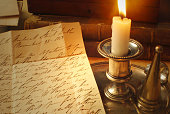 Reading Correspondence from the 1800's by Candle light