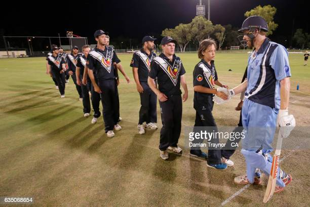 Victorian players line up to shake hands with Nathan Price of New South Wales after the National Indigenous Cricket Championships Final between New...