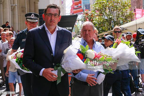 Victorian Premier Daniel Andrews and Melbourne Lord Mayor Robert Doyle lays flowers at Bourke Street Mall on January 21 2017 in Melbourne Australia...