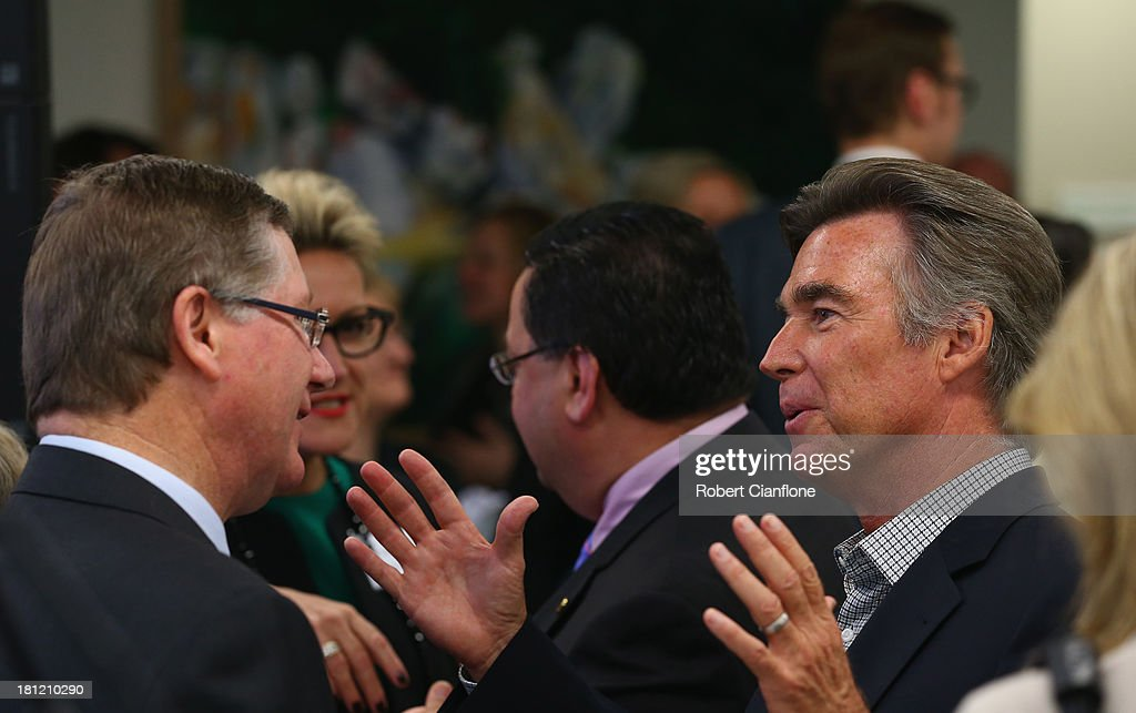 Victorian Premier Denis Napthine speaks with the husband of Olivia Newton-John, John Easterling at the formal opening of the Olivia Newton John Cancer & Wellness Centre at Austin Hospital on September 20, 2013 in Melbourne, Australia.