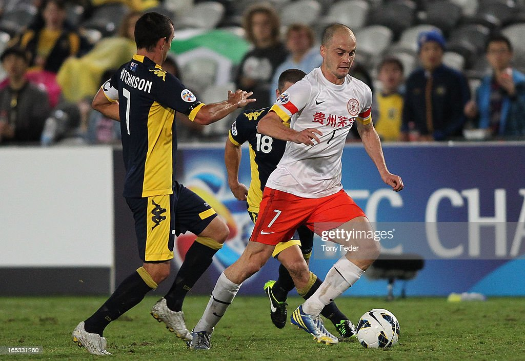 Victorian Rivas Alvaro of Guizhou controls the ball ahead of Mariners defenders during the AFC Asian Champions League match between the Central Coast Mariners and Guizhou at Bluetongue Stadium on April 3, 2013 in Gosford, Australia.