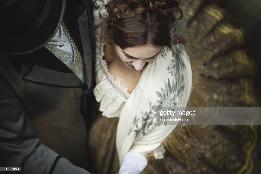 Victorian romantic couple whirls while dancing together. : Stock Photo