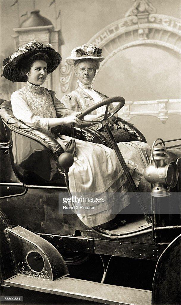 Victorian women in old car