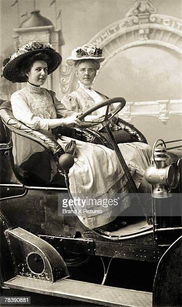 Victorian women in old car