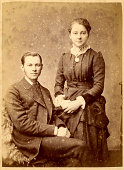 Vintage photograph of a young man and woman from the Victorian era circa 1880.