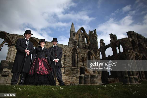 Victoriana fans Norman farmer his wife Jan Farmer and their son Nick Farmer pose outside Whitby Abbey during the Whitby Goth Weekend on April 28 2012...