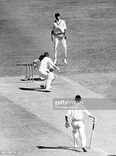 Victoria's Bob Cowper is stumped by India wicketkeeper Farokh Engineer as India's Venkataraman Subramanya and Victoria's Ian Redpath look on