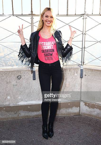 Victoria's Secret Angel Candice Swanepoel lights The Empire State Building In Pink Stripes on December 7 2015 in New York City
