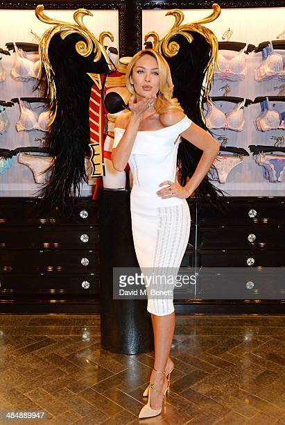 Victoria's Secret Angel Candice Swanepoel poses as she and fellow Angel Adriana Lima speak at the New Bond Street store on April 15 2014 in London...