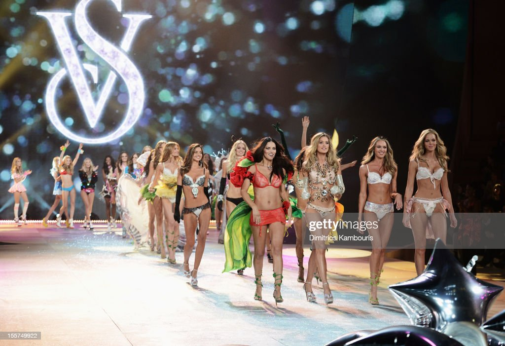 Victoria's Secret Angels <a gi-track='captionPersonalityLinkClicked' href=/galleries/search?phrase=Adriana+Lima&family=editorial&specificpeople=182444 ng-click='$event.stopPropagation()'>Adriana Lima</a>, and <a gi-track='captionPersonalityLinkClicked' href=/galleries/search?phrase=Doutzen+Kroes&family=editorial&specificpeople=859655 ng-click='$event.stopPropagation()'>Doutzen Kroes</a>, <a gi-track='captionPersonalityLinkClicked' href=/galleries/search?phrase=Candice+Swanepoel&family=editorial&specificpeople=4357958 ng-click='$event.stopPropagation()'>Candice Swanepoel</a> and <a gi-track='captionPersonalityLinkClicked' href=/galleries/search?phrase=Erin+Heatherton&family=editorial&specificpeople=5003810 ng-click='$event.stopPropagation()'>Erin Heatherton</a> walk the runway during the 2012 Victoria's Secret Fashion Show at the Lexington Avenue Armory on November 7, 2012 in New York City.