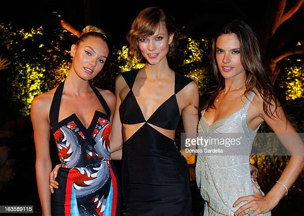 Victoria's Secret Angels Candice Swanepoel Karlie Kloss and Alessandra Ambrosio pose during the Victoria's Secret SWIM 2013 Party hosted by...