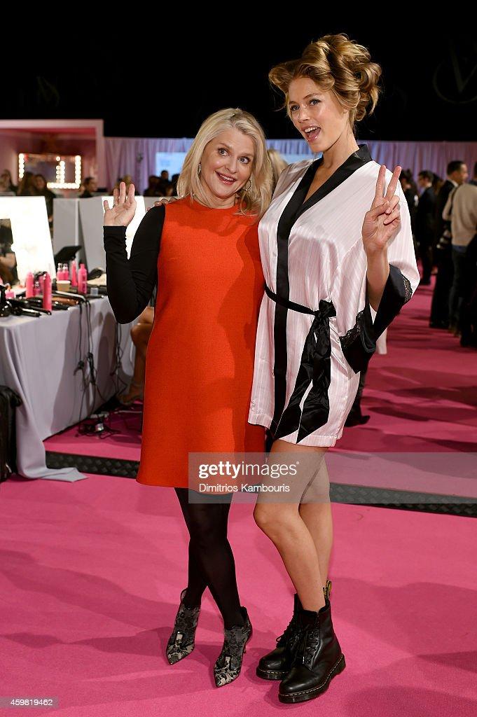 Victoria's Secret CEO Sharen Turney poses with Victoria's Secret model Doutzen Kroes backstage prior the 2014 Victoria's Secret Fashion Show on...