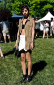 Victorias Secret designer Allie is seen wearing a Zara vest Zara skort Jeffrey Campbell boots and Ray Ban glasses during the 2014 Governors Ball...
