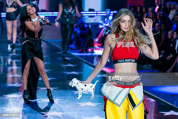 Victoria's Secret Fashion Show Pictured Model Gigi Hadid walks the runway while Selena Gomez performs at the 2015 Victoria's Secret Fashion Show in...