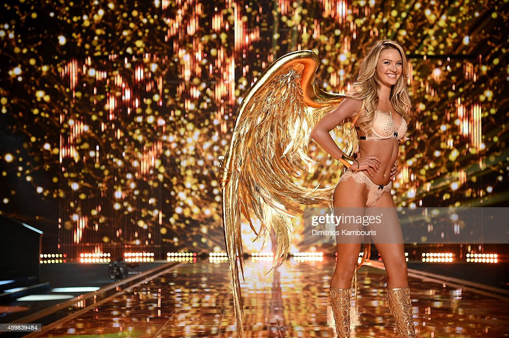 Victoria's Secret model <a gi-track='captionPersonalityLinkClicked' href=/galleries/search?phrase=Candice+Swanepoel&family=editorial&specificpeople=4357958 ng-click='$event.stopPropagation()'>Candice Swanepoel</a> walks the runway during the 2014 Victoria's Secret Fashion Show at Earl's Court exhibition centre on December 2, 2014 in London, England.