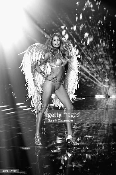 Victoria's Secret model Doutzen Kroes walks the runway during the 2014 Victoria's Secret Fashion Show at Earl's Court exhibition centre on December 2...